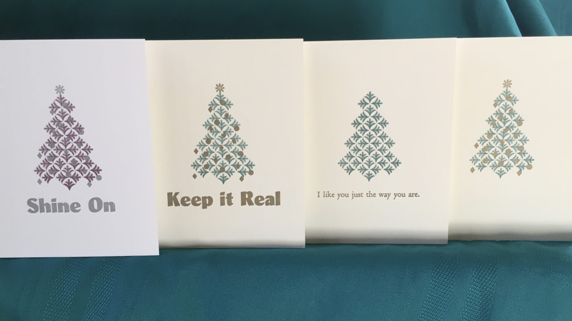 Shows 4 new Christmas card designs